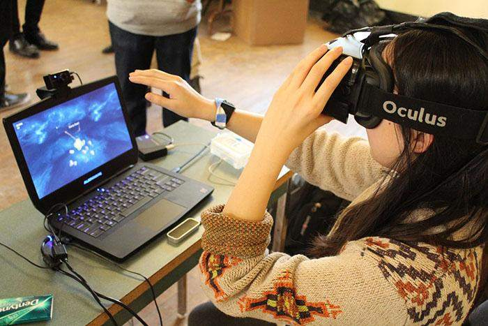 Playing Space Invader in VR on the Oculus Rift, image credited to Rui Jie Wang.