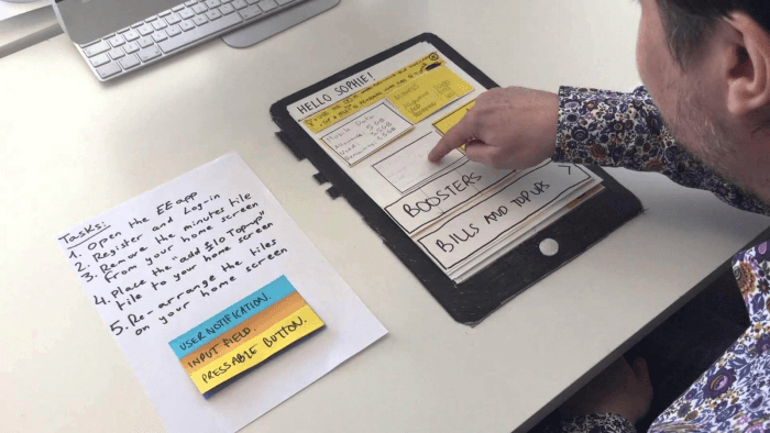 Man touching paper which shows mock application layout