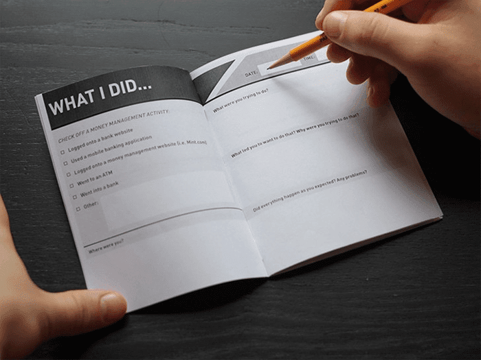 Photo of filling out task checklist diary
