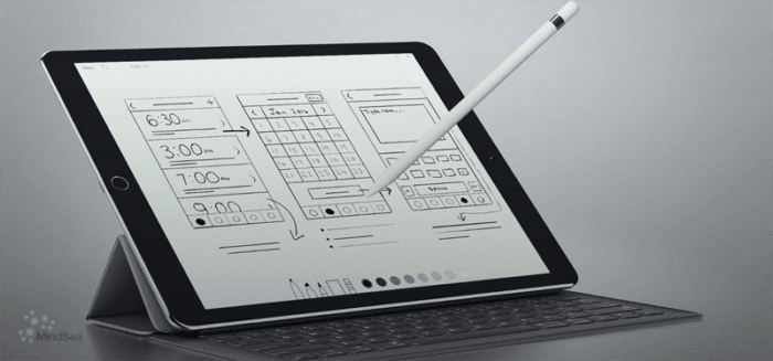 Stylus and tablet being used to digitally sketch an interface design.