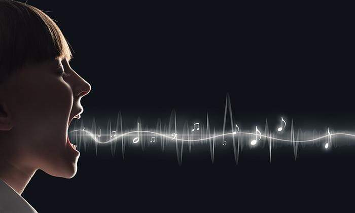 Woman with mouth open and music notes emanate from her mouth.