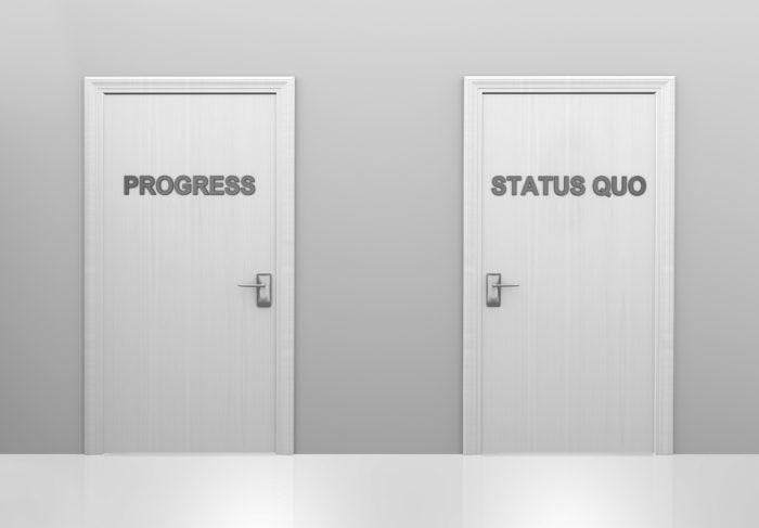 Two doors saying progress and status quo