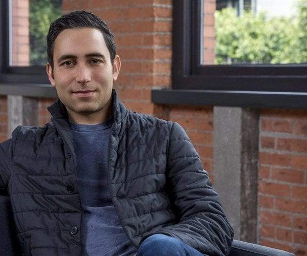 Scott Belsky sitting in chair