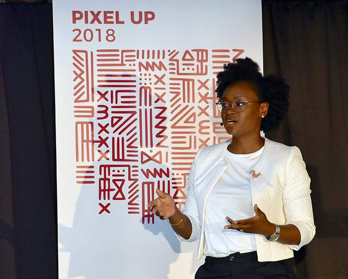 Ladies that UX, London Organizer, Lola Oyelayo-Pearson presenting at Pixel Up 2018