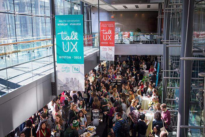 An aerial view of some of the Talk UX banner designs created by hybrid designer, Katie Langerman