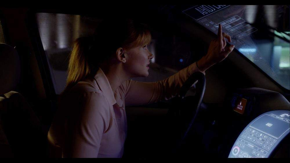 An actress In the Black Mirror Episode, Nosedive, interacts with an FUI in the form of a vehicle's HUD that is not visible during the filming of the scene.