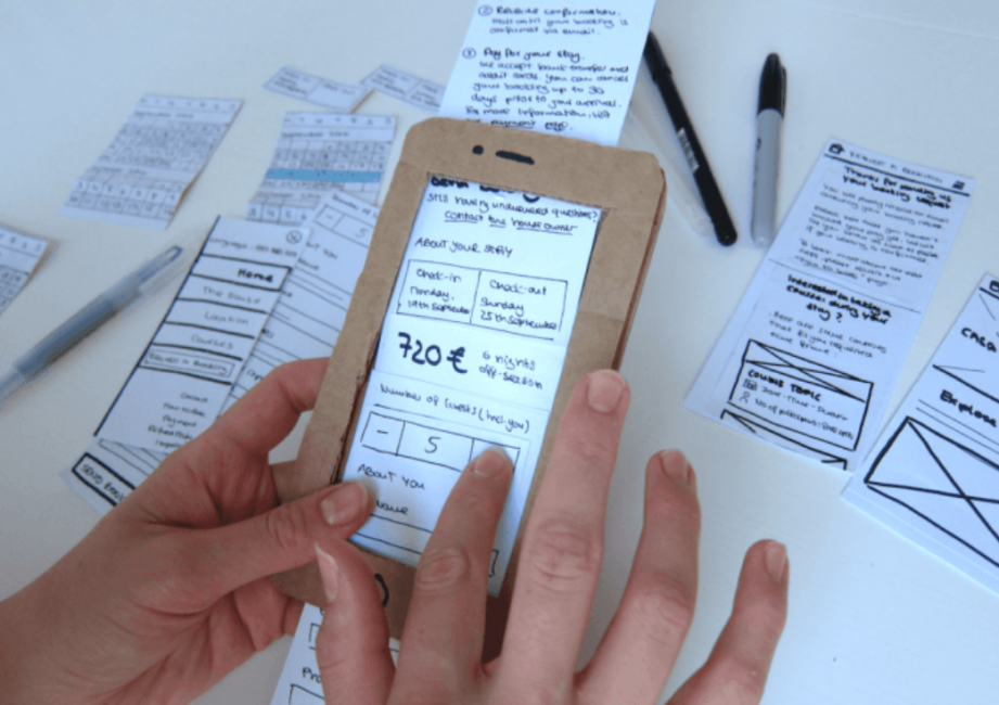 Designers paper prototype of a mobile app
