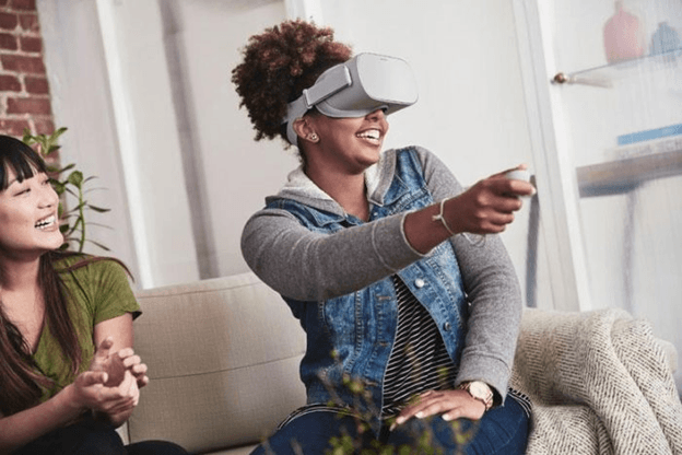 Woman playing with the Oculus Go Virtual Reality all-in-one headset