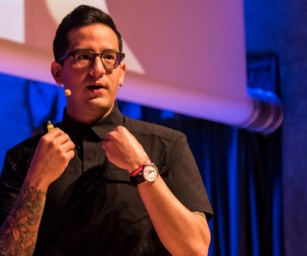 Shopify's Product designer, Ricardo Vazquez speaking at an event