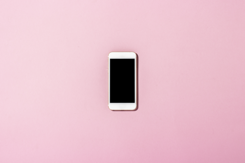 iphone on a pink background