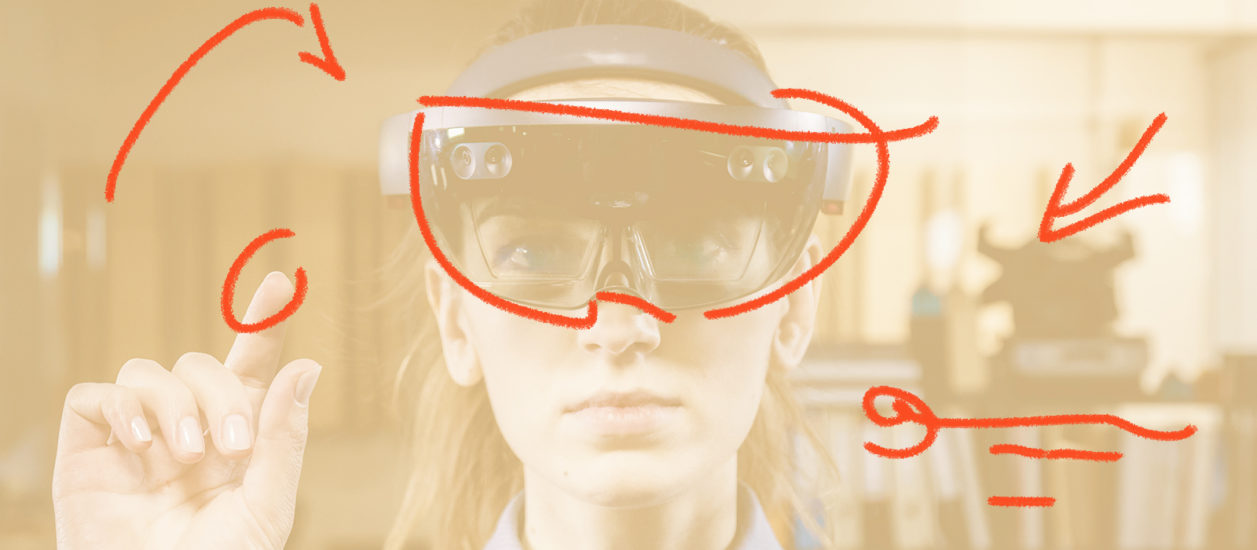 Photograph of a woman with an AR mask penciled in over her face.