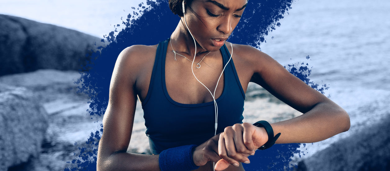 Women checking her smartwatch while exercising