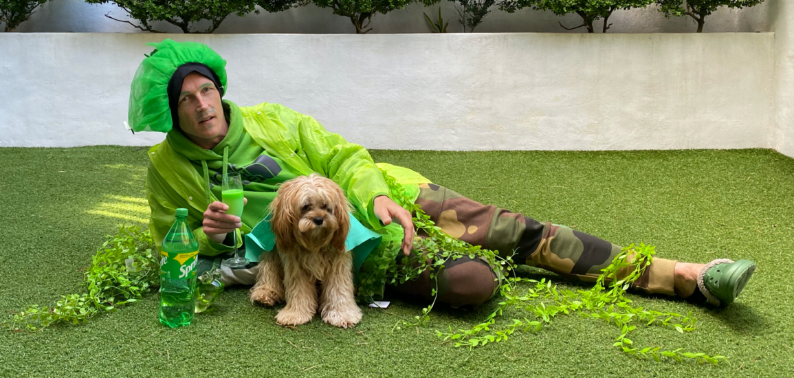 Guy Ligertwood poses with his dog in a St. Patrick's Day costume.